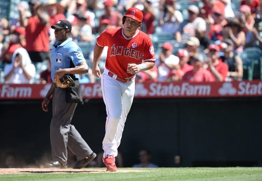July 14, 2019; Anaheim, CA, USA; Los Angeles Angels third baseman Matt Thaiss (23) scores a run against the Seattle Mariners during the fifth inning at Angel Stadium of Anaheim. Mandatory Credit: Gary A. Vasquez-USA TODAY Sports