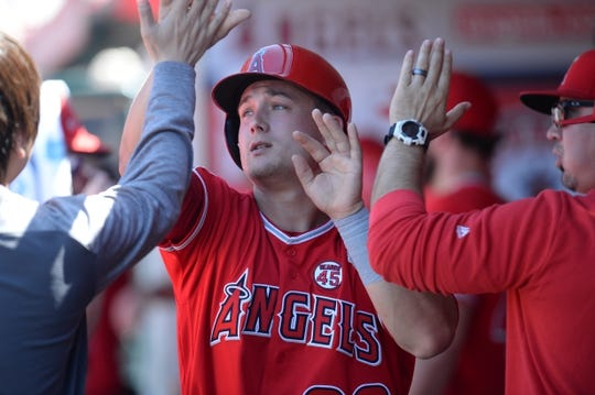 July 14, 2019; Anaheim, CA, USA; Los Angeles Angels third baseman Matt Thaiss (23) is greeted after scoring a run against the Seattle Mariners during the fifth inning at Angel Stadium of Anaheim. Mandatory Credit: Gary A. Vasquez-USA TODAY Sports