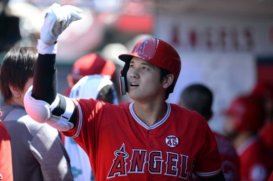July 14, 2019; Anaheim, CA, USA; Los Angeles Angels designated hitter Shohei Ohtani (17) is greeted after hitting a sacrifice RBI against the Seattle Mariners during the fifth inning at Angel Stadium of Anaheim. Mandatory Credit: Gary A. Vasquez-USA TODAY Sports
