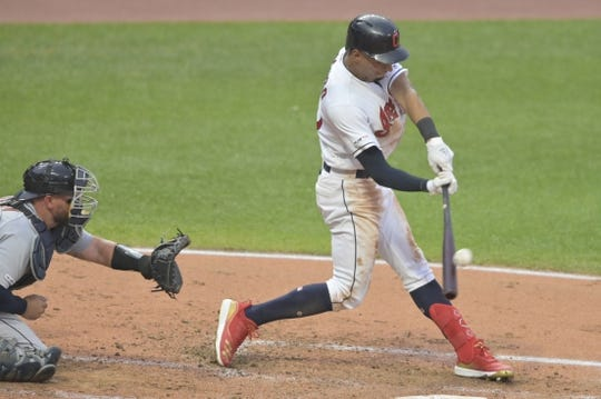 Jul 16, 2019; Cleveland, OH, USA; Cleveland Indians center fielder Oscar Mercado (35) hits a two-run home run in the second inning against the Detroit Tigers at Progressive Field. Mandatory Credit: David Richard-USA TODAY Sports