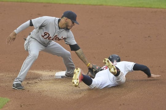 Jul 16, 2019; Cleveland, OH, USA; Cleveland Indians center fielder Oscar Mercado (35) steals second base beside Detroit Tigers second baseman Harold Castro (30) in the first inning at Progressive Field. Mandatory Credit: David Richard-USA TODAY Sports