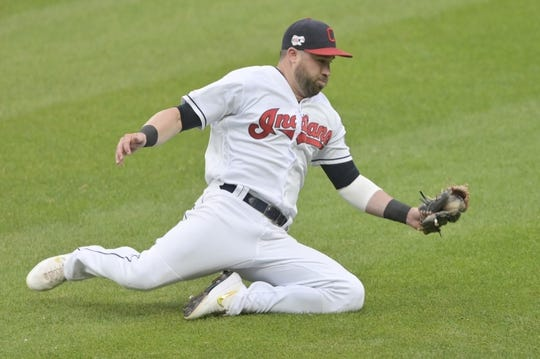 Jul 16, 2019; Cleveland, OH, USA; Cleveland Indians second baseman Jason Kipnis (22) slides while fielding a ground ball in the second inning against the Detroit Tigers at Progressive Field. Mandatory Credit: David Richard-USA TODAY Sports
