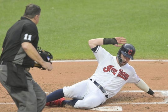 Jul 16, 2019; Cleveland, OH, USA; Cleveland Indians right fielder Tyler Naquin (30) scores a run in the second inning against the Detroit Tigers at Progressive Field. Mandatory Credit: David Richard-USA TODAY Sports