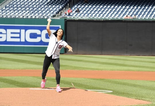 Jul 25, 2019; Washington, DC, USA; US Women's National Team soccer player Ali Krieger throws out the ceremonial first pitch before the game between the Washington Nationals and the Colorado Rockies at Nationals Park. Mandatory Credit: Brad Mills-USA TODAY Sports
