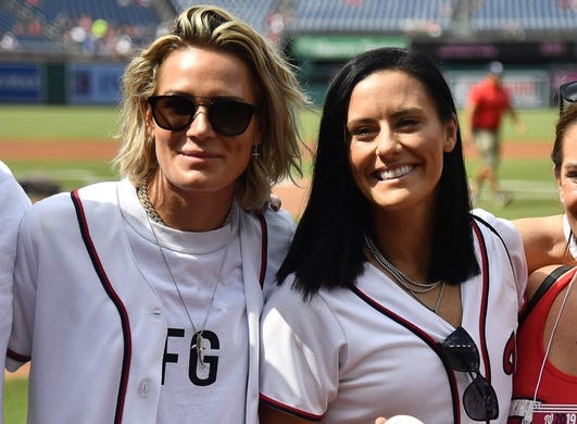 Jul 25, 2019; Washington, DC, USA; US Women's National soccer team members Ali Krieger and Ashlyn Harris on the field before the game between the Washington Nationals and the Colorado Rockies at Nationals Park. Mandatory Credit: Brad Mills-USA TODAY Sports