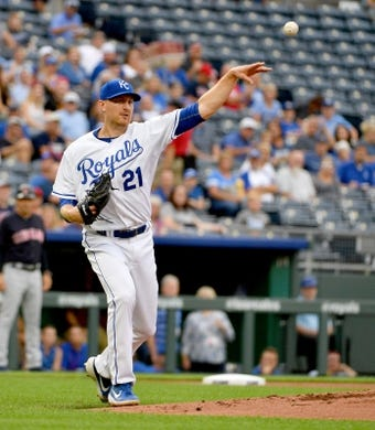 Jul 25, 2019; Kansas City, MO, USA; Kansas City Royals starting pitcher Mike Montgomery (21) fields a ground ball and throws to first base for an out in the first inning against the Cleveland Indians at Kauffman Stadium. Mandatory Credit: Denny Medley-USA TODAY Sports