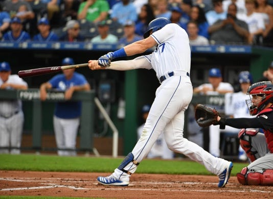 Jul 25, 2019; Kansas City, MO, USA; Kansas City Royals third baseman Hunter Dozier (17) connects for a two run home run in the first inning against the Cleveland Indians at Kauffman Stadium. Mandatory Credit: Denny Medley-USA TODAY Sports