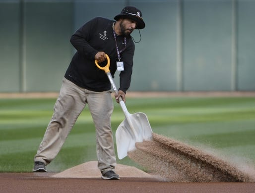 Jul 25, 2019; Chicago, IL, USA; Chicago White Sox grounds crew member Manny Ortega prepares the field before the game between the Chicago White Sox and the Minnesota Twins at Guaranteed Rate Field. Mandatory Credit: David Banks-USA TODAY Sports