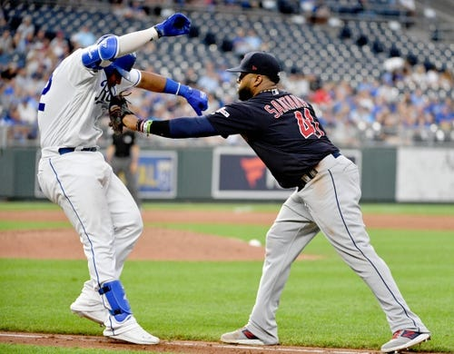 Jul 25, 2019; Kansas City, MO, USA; Kansas City Royals catcher Meibrys Viloria (72) is tagged out by Cleveland Indians first baseman Carlos Santana (41) in the fourth inning at Kauffman Stadium. Mandatory Credit: Denny Medley-USA TODAY Sports