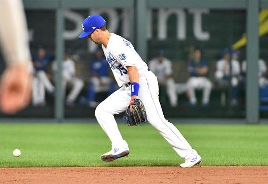 Jul 25, 2019; Kansas City, MO, USA; Kansas City Royals second baseman Whit Merrifield (15) makes a fielding error at second base allowing a run in the sixth inning against the Cleveland Indians at Kauffman Stadium. Mandatory Credit: Denny Medley-USA TODAY Sports