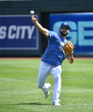 Jul 28, 2019; Kansas City, MO, USA; Kansas City Royals starting pitcher Jakob Junis (65) warms up in the outfield before the game against the Cleveland Indians at Kauffman Stadium. Mandatory Credit: Denny Medley-USA TODAY Sports