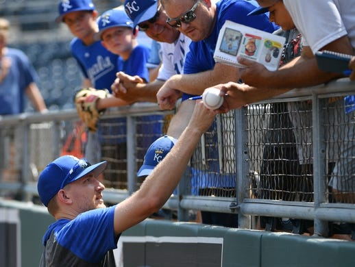 Jul 28, 2019; Kansas City, MO, USA; Kansas City Royals relief pitcher Mike Montgomery (21) signs autographs for fans before the game against the Cleveland Indians at Kauffman Stadium. Mandatory Credit: Denny Medley-USA TODAY Sports