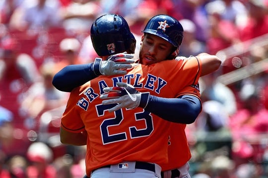 Jul 28, 2019; St. Louis, MO, USA; Houston Astros center fielder George Springer (4) hugs right fielder Michael Brantley (23) after hitting a solo home run off of St. Louis Cardinals starting pitcher Dakota Hudson (not pictured) during the first inning at Busch Stadium. Mandatory Credit: Jeff Curry-USA TODAY Sports