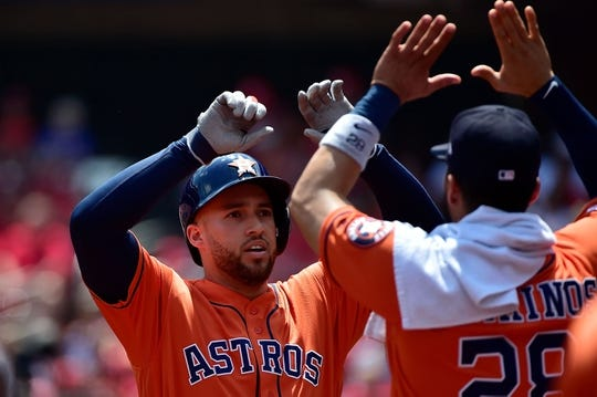 Jul 28, 2019; St. Louis, MO, USA; Houston Astros center fielder George Springer (4) celebrates with Robinson Chirinos (28) after hitting a solo home run off of St. Louis Cardinals starting pitcher Dakota Hudson (not pictured) during the first inning at Busch Stadium. Mandatory Credit: Jeff Curry-USA TODAY Sports
