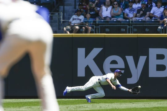 Jul 28, 2019; Seattle, WA, USA; Seattle Mariners right fielder Kristopher Negron (45) catches a line drive against the Detroit Tigers during the second inning at T-Mobile Park. Mandatory Credit: Joe Nicholson-USA TODAY Sports