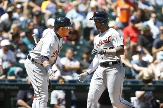 Jul 28, 2019; Seattle, WA, USA; Detroit Tigers left fielder Niko Goodrum, right, is greeted by designated hitter Miguel Cabrera, left, after hitting a solo home run against the Seattle Mariners during the fourth inning at T-Mobile Park. Mandatory Credit: Joe Nicholson-USA TODAY Sports