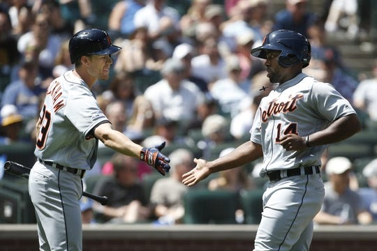 Jul 28, 2019; Seattle, WA, USA; Detroit Tigers left fielder Christin Stewart (14) is greeted by shortstop Gordon Beckham (29) after scoring a run against the Seattle Mariners during the fifth inning at T-Mobile Park. Mandatory Credit: Joe Nicholson-USA TODAY Sports