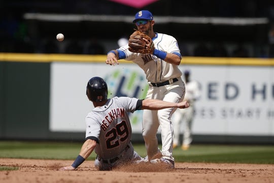 Jul 28, 2019; Seattle, WA, USA; Seattle Mariners second baseman Austin Nola (23) turns a double play against Detroit Tigers shortstop Gordon Beckham (29) during the fifth inning at T-Mobile Park. Mandatory Credit: Joe Nicholson-USA TODAY Sports