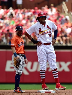 Jul 28, 2019; St. Louis, MO, USA; St. Louis Cardinals right fielder Jose Martinez (38) talks with Houston Astros second baseman Jose Altuve (27) during the first inning at Busch Stadium. Mandatory Credit: Jeff Curry-USA TODAY Sports