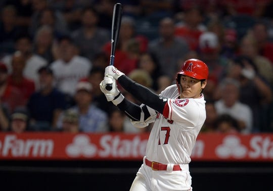 July 30, 2019; Anaheim, CA, USA; Los Angeles Angels designated hitter Shohei Ohtani (17) hits a single against the Detroit Tigers during the fifth inning at Angel Stadium of Anaheim. Mandatory Credit: Gary A. Vasquez-USA TODAY Sports