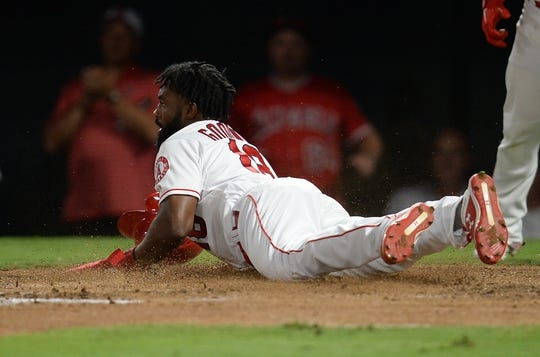 July 30, 2019; Anaheim, CA, USA; Los Angeles Angels left fielder Brian Goodwin (18) scores a run against the Detroit Tigers during the fifth inning at Angel Stadium of Anaheim. Mandatory Credit: Gary A. Vasquez-USA TODAY Sports