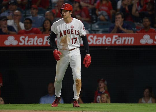 July 30, 2019; Anaheim, CA, USA; Los Angeles Angels designated hitter Shohei Ohtani (17) scores a run against the Detroit Tigers during the fifth inning at Angel Stadium of Anaheim. Mandatory Credit: Gary A. Vasquez-USA TODAY Sports