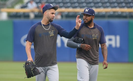 Aug 5, 2019; Pittsburgh, PA, USA;  Milwaukee Brewers relief pitchers Alex Claudio (left) and  Jeremy Jeffress (right) talk on the field before playing the Pittsburgh Pirates at PNC Park. Mandatory Credit: Charles LeClaire-USA TODAY Sports