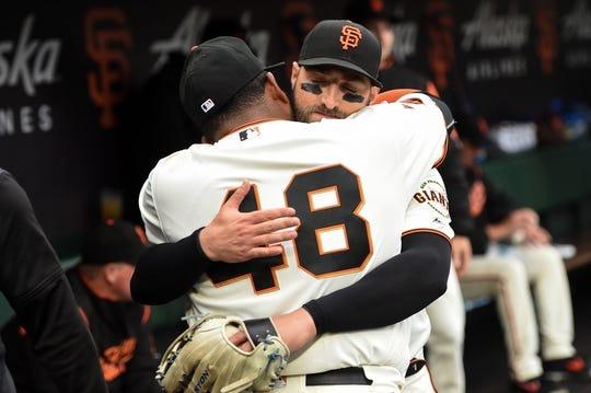 Aug 5, 2019; San Francisco, CA, USA; San Francisco Giants center fielder Kevin Pillar (1) hugs teammate Pablo Sandoval (48) before the game against the Washington Nationals at Oracle Park. Mandatory Credit: Cody Glenn-USA TODAY Sports