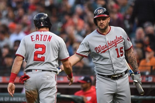 Aug 5, 2019; San Francisco, CA, USA; Washington Nationals outfielder Adam Eaton (2) celebrates with teammate Matt Adams (15) after scoring a run against the San Francisco Giants in the third inning at Oracle Park. Mandatory Credit: Cody Glenn-USA TODAY Sports