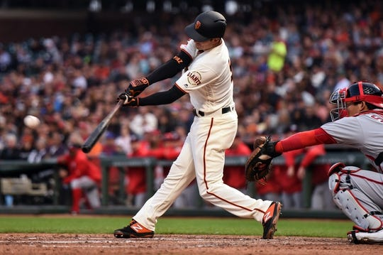 Aug 5, 2019; San Francisco, CA, USA; San Francisco Giants left fielder Mike Yastrzemski (5) hits a single against the Washington Nationals in the third inning at Oracle Park. Mandatory Credit: Cody Glenn-USA TODAY Sports