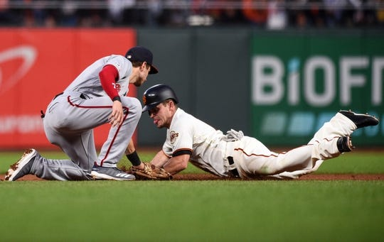 Aug 5, 2019; San Francisco, CA, USA; Washington Nationals shortstop Trea Turner (7) tags out San Francisco Giants second baseman Scooter Gennett (14) on a steal attempt at second base in the fourth inning at Oracle Park. Mandatory Credit: Cody Glenn-USA TODAY Sports
