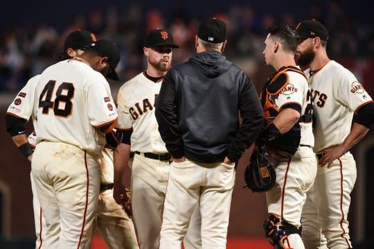Aug 5, 2019; San Francisco, CA, USA; San Francisco Giants relief pitcher Sam Coonrod (65) reacts during a meeting on the mound in the fifth inning against the Washington Nationals at Oracle Park. Mandatory Credit: Cody Glenn-USA TODAY Sports