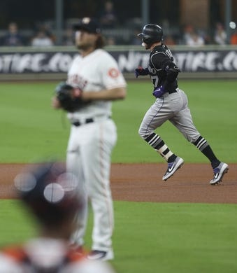 Aug 7, 2019; Houston, TX, USA; Colorado Rockies shortstop Trevor Story (27) rounds the bases after hitting a home run against Houston Astros starting pitcher Gerrit Cole (45) in the first inning at Minute Maid Park. Mandatory Credit: Thomas B. Shea-USA TODAY Sports