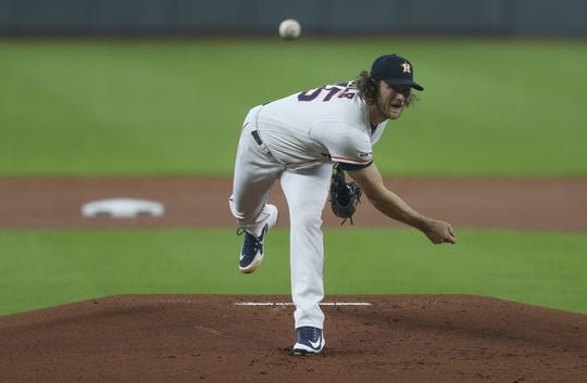 Aug 7, 2019; Houston, TX, USA; Houston Astros starting pitcher Gerrit Cole (45) pitches against the Colorado Rockies in the first inning at Minute Maid Park. Mandatory Credit: Thomas B. Shea-USA TODAY Sports