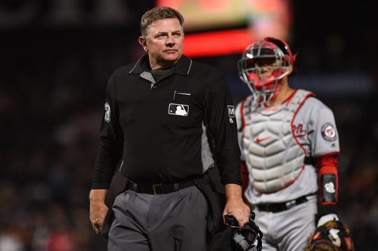 Aug 5, 2019; San Francisco, CA, USA; Home plate umpire Greg Gibson during the game between the Washington Nationals and the San Francisco Giants at Oracle Park. Mandatory Credit: Cody Glenn-USA TODAY Sports