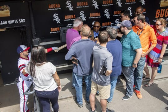 Aug 11, 2019; Chicago, IL, USA; Former Chicago White Sox player Harold Baines is interviewed by members of the media and Chicago White Sox second baseman Yolmer Sanchez (left) prior to a game between the Chicago White Sox and the Oakland Athletics at Guaranteed Rate Field. Mandatory Credit: Patrick Gorski-USA TODAY Sports