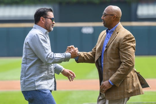Aug 11, 2019; Chicago, IL, USA; Former Chicago White Sox player Harold Baines shakes hands with former manager Ozzie Guillen as he is honored during a ceremony reflecting his Hall of Fame induction prior to a game between the Chicago White Sox and the Oakland Athletics at Guaranteed Rate Field. Mandatory Credit: Patrick Gorski-USA TODAY Sports