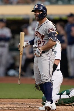 Aug 15, 2019; Oakland, CA, USA; Houston Astros second baseman Jose Altuve (27) watches bats against the Oakland Athletics at the Oakland Coliseum. Mandatory Credit: Stan Szeto-USA TODAY Sports