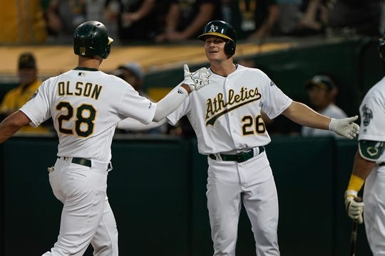 Aug 15, 2019; Oakland, CA, USA; Oakland Athletics first baseman Matt Olson (28) celebrates with third baseman Matt Chapman (26) after hitting a home run against the Houston Astros during the fourth inning at the Oakland Coliseum. Mandatory Credit: Stan Szeto-USA TODAY Sports