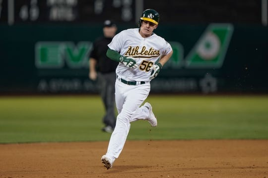 Aug 15, 2019; Oakland, CA, USA; Oakland Athletics second baseman Corban Joseph (56) runs the bases after hitting a solo home run against the Houston Astros during the fourth inning at the Oakland Coliseum. Mandatory Credit: Stan Szeto-USA TODAY Sports