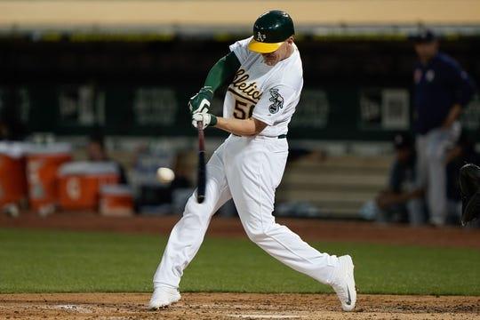 Aug 15, 2019; Oakland, CA, USA; Oakland Athletics second baseman Corban Joseph (56) hits a solo home run against the Houston Astros during the fourth inning at the Oakland Coliseum. Mandatory Credit: Stan Szeto-USA TODAY Sports