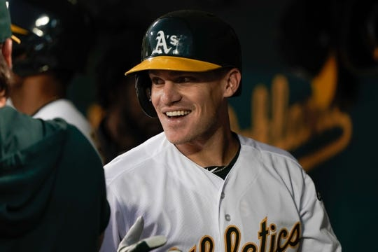 Aug 15, 2019; Oakland, CA, USA; Oakland Athletics second baseman Corban Joseph (56) reacts after hitting a solo home run against the Houston Astros during the fourth inning at the Oakland Coliseum. Mandatory Credit: Stan Szeto-USA TODAY Sports
