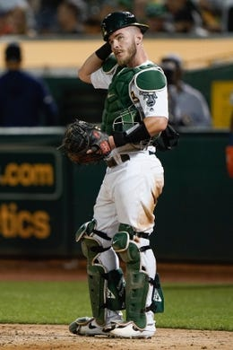 Aug 15, 2019; Oakland, CA, USA; Oakland Athletics catcher Chris Herrmann (5) reacts against the Houston Astros during the sixth inning at the Oakland Coliseum. Mandatory Credit: Stan Szeto-USA TODAY Sports