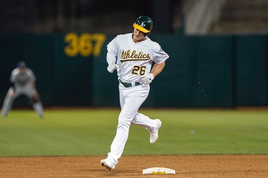 Aug 15, 2019; Oakland, CA, USA; Oakland Athletics third baseman Matt Chapman (26) runs the bases after hitting a solo home run against the Houston Astros during the sixth inning at the Oakland Coliseum. Mandatory Credit: Stan Szeto-USA TODAY Sports