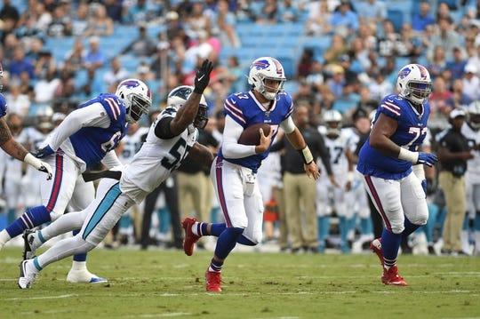 Aug 16, 2019; Charlotte, NC, USA; Buffalo Bills quarterback Josh Allen (17) is tackled by Carolina Panthers defensive end Bruce Irvin (55) at Bank of America Stadium. Mandatory Credit: Bob Donnan-USA TODAY Sports