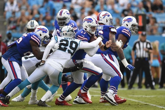 Aug 16, 2019; Charlotte, NC, USA; Buffalo Bills quarterback Josh Allen (17) is tackled by Carolina Panthers cornerback Corn Elder (29) at Bank of America Stadium. Mandatory Credit: Bob Donnan-USA TODAY Sports