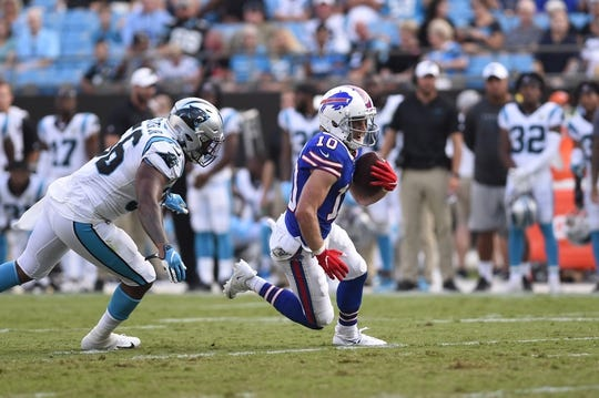 Aug 16, 2019; Charlotte, NC, USA; Buffalo Bills wide receiver Cole Beasley (10) with the ball as Carolina Panthers linebacker Jermaine Carter (56) defends at Bank of America Stadium. Mandatory Credit: Bob Donnan-USA TODAY Sports