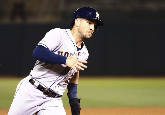 Aug 16, 2019; Oakland, CA, USA; Houston Astros third baseman Alex Bregman (2) rounds third base to score a run against the Oakland Athletics during the sixth inning at Oakland Coliseum. Mandatory Credit: Kelley L Cox-USA TODAY Sports