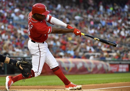 Aug 17, 2019; Washington, DC, USA; Washington Nationals center fielder Victor Robles (16) hits a single against the Milwaukee Brewers during the second inning at Nationals Park. Mandatory Credit: Brad Mills-USA TODAY Sports