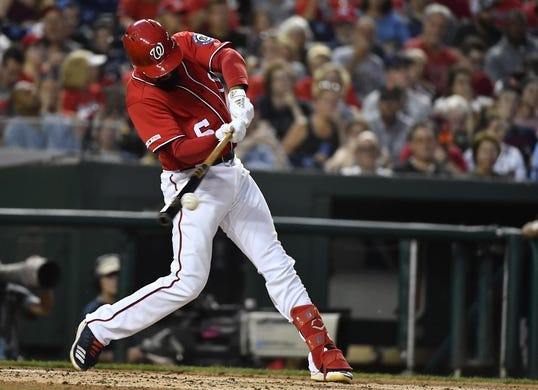 Aug 17, 2019; Washington, DC, USA; Washington Nationals third baseman Anthony Rendon (6) hits a single against the Milwaukee Brewers during the third inning at Nationals Park. Mandatory Credit: Brad Mills-USA TODAY Sports